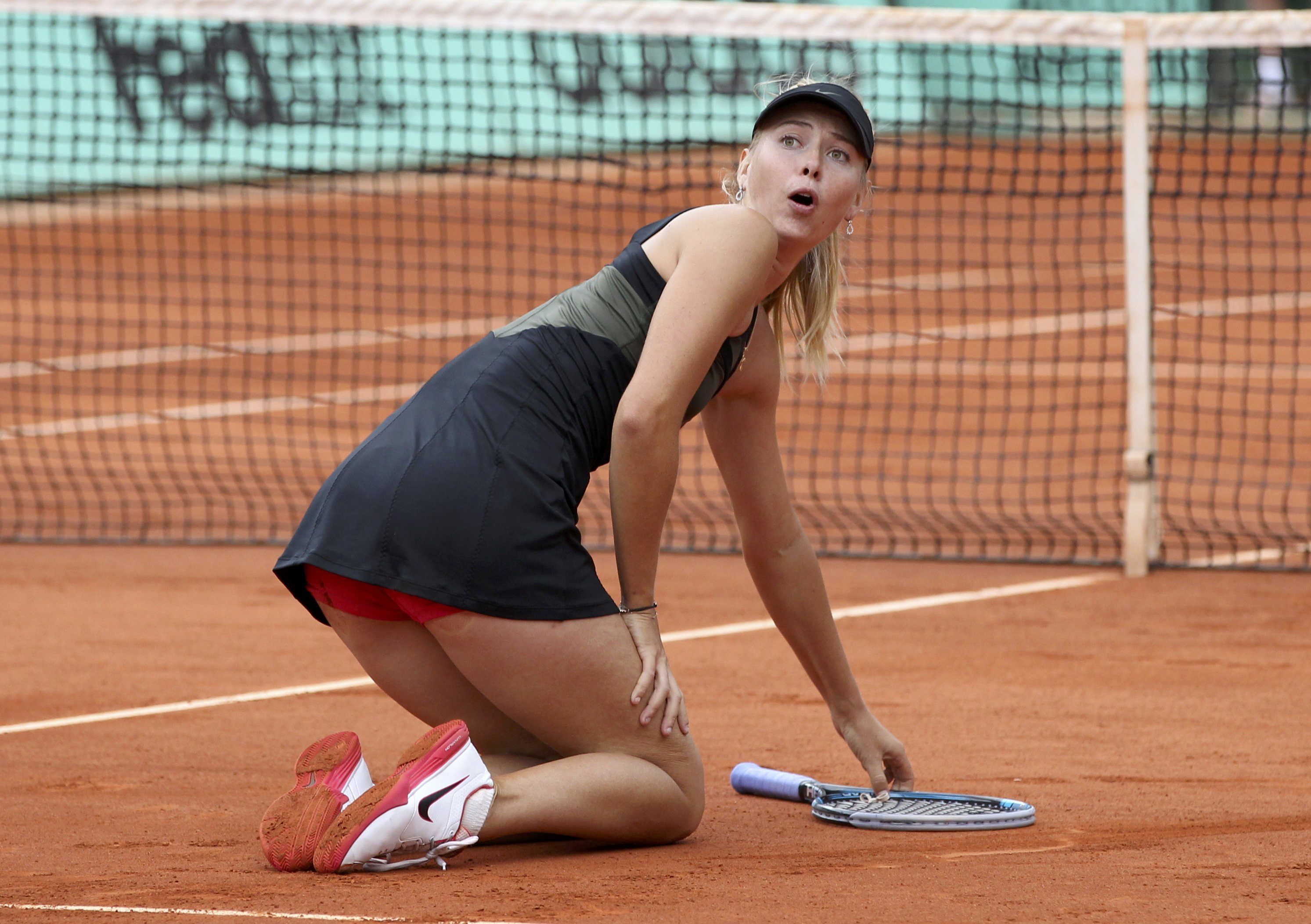 Sharapova of Russia reacts after winning her women's singles final match against Errani of Italy at the French Open tennis tournament at the Roland Garros stadium in Paris