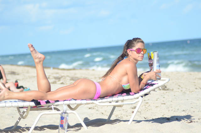 Fitness model Michelle Lewin works on her tan as she hits 4.5m social media followers