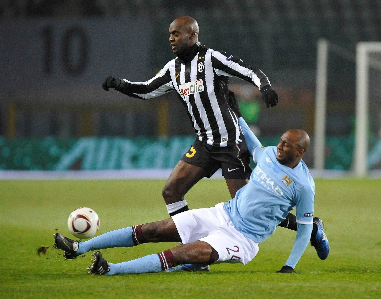 Juventus' Sissoko is challenged by Manchester City's Vieira during their Europa League soccer match at the Olympic stadium in Turin