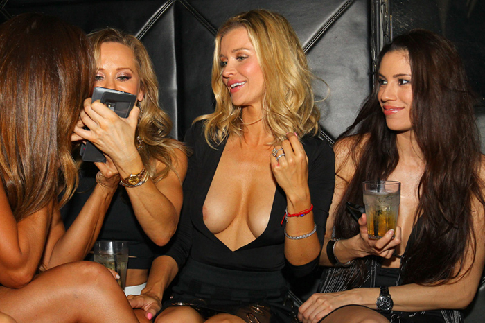 EXCLUSIVE: Joanna Krupa has girls night out at Mynt Lounge in Miami Beach. The reality star and her friends, including former cast mate Karent Sierra, danced and enjoyed the night as they played in the DJ booth, poured each other shots, and took selfies throughout the night. While letting her hair down and partying in the club owned by her husband Romain, Joanna had a slight wardrobe malfunction accidentally exposing herself to the crowd in the club. Pictured: Joanna Krupa Ref: SPL1149107  111015   EXCLUSIVE Picture by: Ralph Notaro / Splash News Splash News and Pictures Los Angeles:	310-821-2666 New York:	212-619-2666 London:	870-934-2666 photodesk@splashnews.com